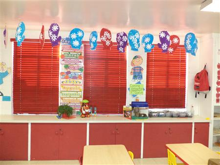 Cordless window coverings and locking cabinets keep children safe and secure in a classroom setting