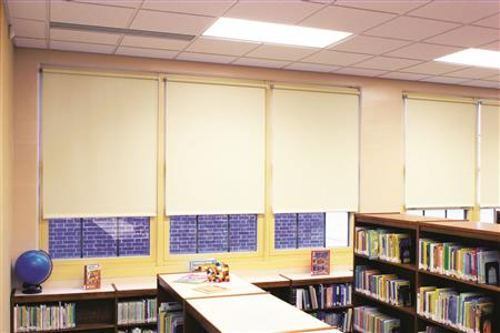 Cordless roller shades provide important privacy as well as protection from the sun during the hottest hours of the day, keeping this library comfortable