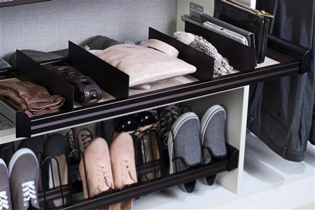 A pull-out shoe rack and shelf make a hotel closet much more functional and convenient