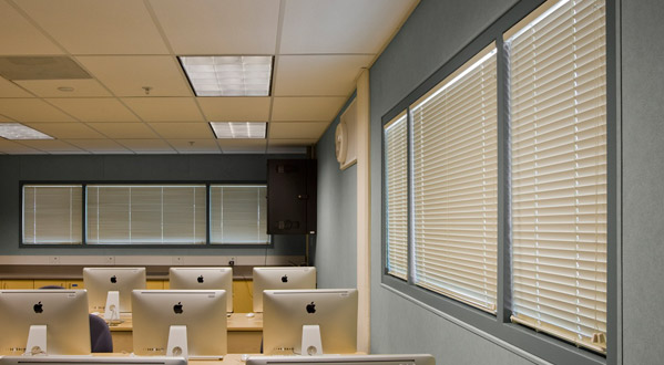 Protect Office Equipment From Sun Expsosure While Controlling The Temperature Of A Room With Window Blinds
